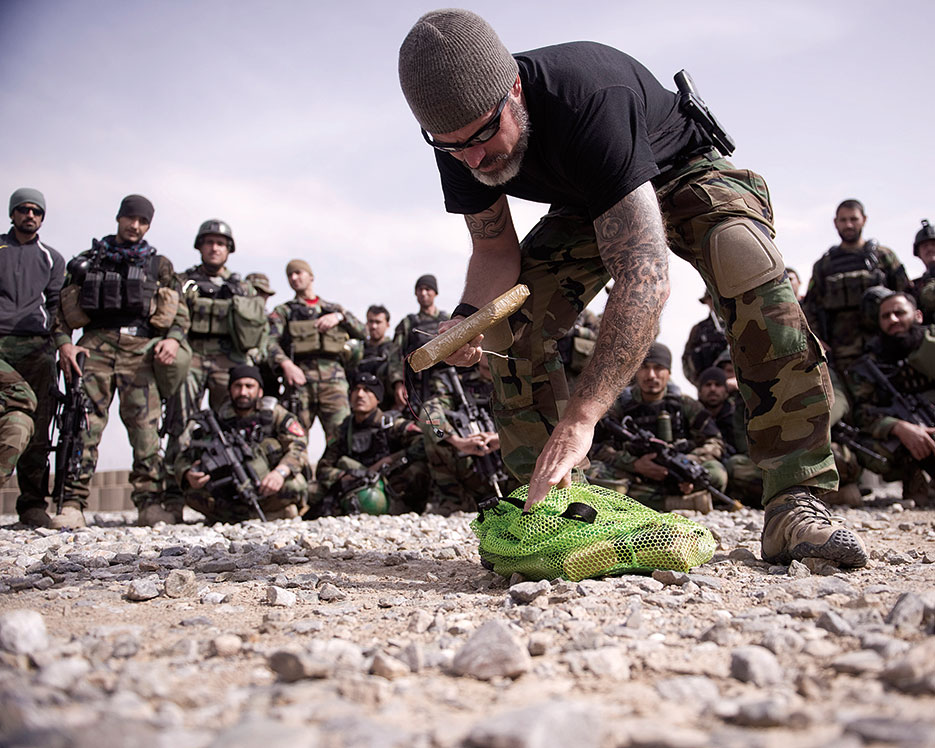 Joint Expeditionary Team advisor teaches Afghan National Army commandos about improvised explosive devices at Camp McCloskey, Afghanistan (DOD)