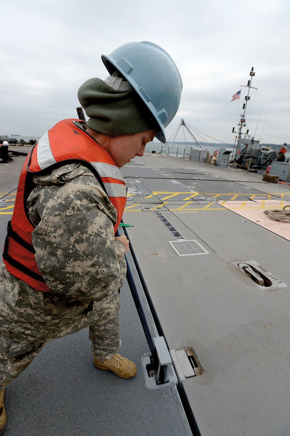 Soldier assigned to 331st Transportation Company locks in portion of Trident pier during Combined/Joint Logistics Over-the-Shore naval exercise on Korean Peninsula, April 15, 2013, intended to improve logistics interoperability, communication, and cooperation between the United States and South Korea (U.S. Navy/Elisandro T. Diaz)