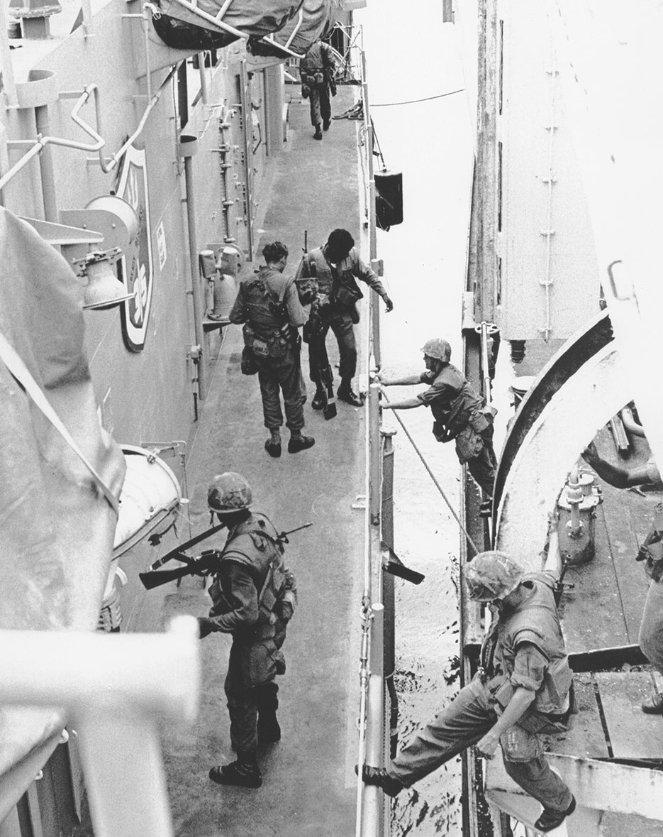 Marines reboard USS Harold E. Holt (DE-1974) from SS Mayaguez after merchant ship's recovery, Koh Tang Island, Cambodia, May 14, 1975 (DOD/Michael Chan)