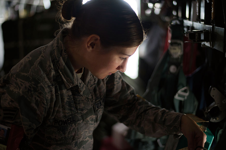 Senior Airman inspects parachutes on a C-130 Hercules aircraft during Red Flag–Alaska 14-3 at Joint Base Elmendorf-Richardson, Alaska, August 5, 2014 (U.S. Air Force/Chad C. Strohmeyer)