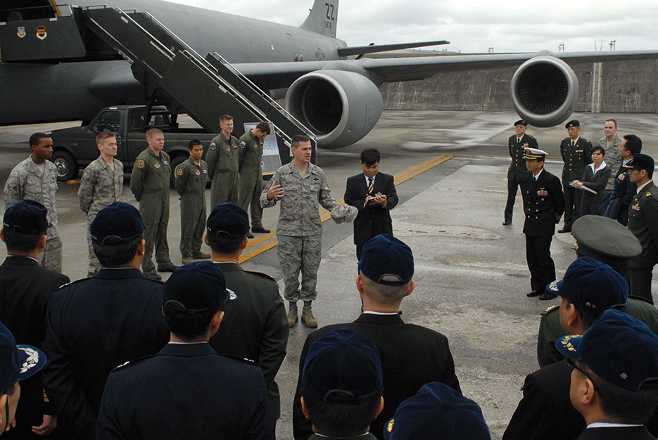 Colonel Lenny Richoux, 18th Wing vice commander, addresses group of students and instructors from Japan Self Defense Force Joint Staff College at Kadena Air Base as part of Japan's year-long advanced professional military education program, February 3, 2010 (U.S. Air Force/Christopher Hummel)