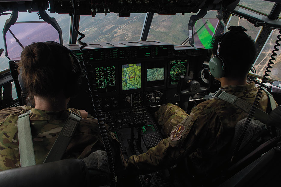 Two pilots assigned to 71st Rescue Squadron at Moody Air Force Base, Georgia, fly C-130J Hercules during rescue and refueling training near Beja Air Base, Portugal, October 23, 2015, in support of Trident Juncture 2015 (U.S. Air Force/Luke Kitterman)