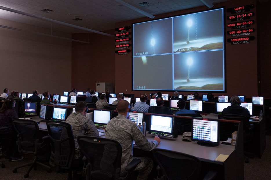Members of 576th Flight Test Squadron monitor operational test launch of unarmed Minuteman III missile, March 27, 2015, at Vandenberg Air Force Base, California (DOD/Michael Peterson)