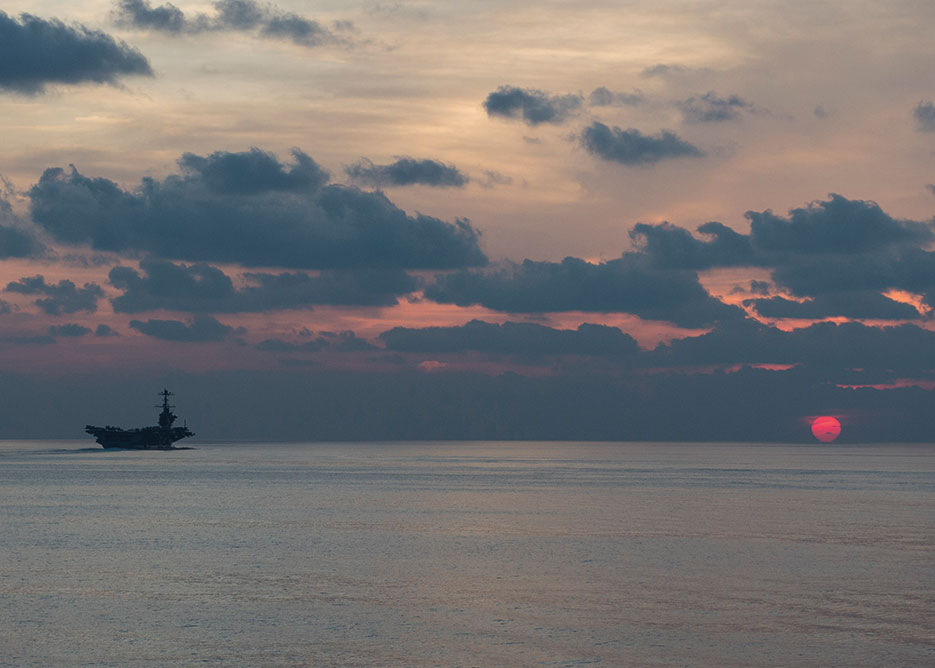USS John C. Stennis steams at dusk in South China Sea, supporting security and stability in Indo-Asia Pacific, April 25, 2016 (U.S. Navy/Emiline L.M. Senn)