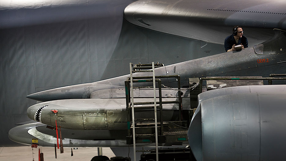 Airman loads AGM-86B air-cruise launch trainer missile onto B-52H Stratofortress, February 26, 2014, at Minot Air Force Base, North Dakota (U.S. Air Force/Aaron D. Allmon II)