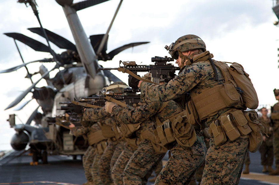 Marines, assigned to 31st Marine Expeditionary Unit, fire M4 service rifles during exercise on flight deck of USS Bonhomme Richard, currently under way conducting operations in U.S. 7th Fleet area of responsibility, February 10, 2015 (U.S. Navy/Matthew Dickinson)