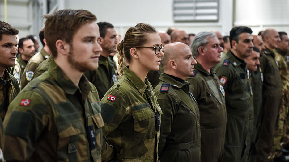 Norwegian soldiers stand at attention during Baltic Air Policing change of command ceremony, April 30, 2015 (NATO)