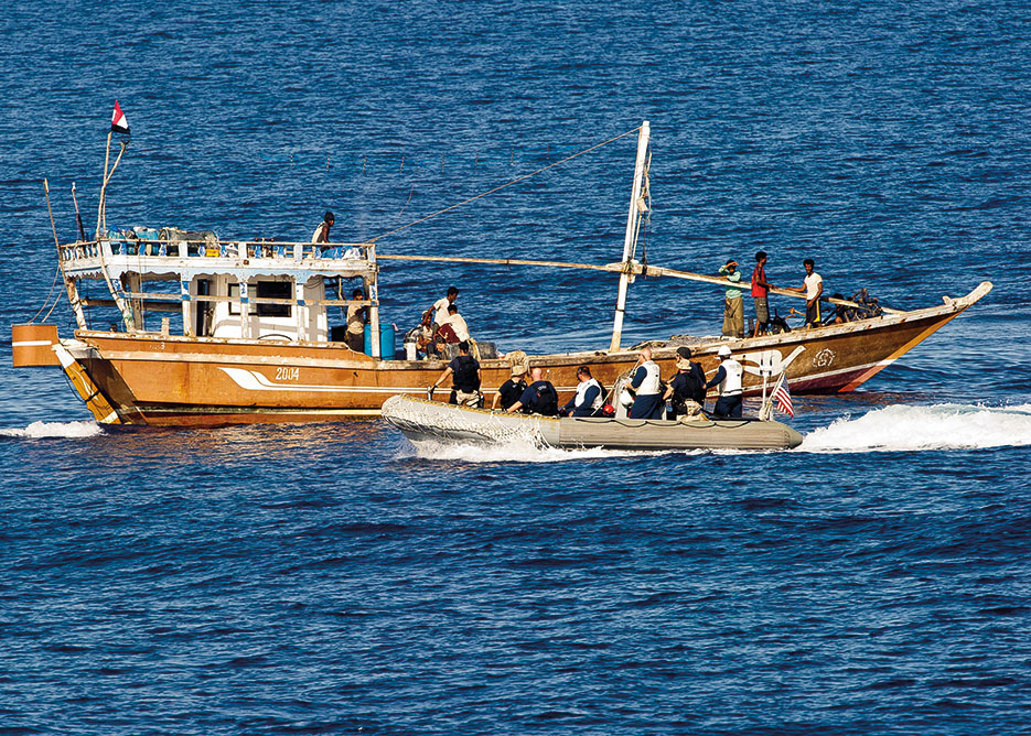 Members of visit, board, search, and seizure team of guided missile frigate USS Taylor, assigned to Commander, NATO Task Force 508, supporting Operation Ocean Shield, respond to disabled Yemeni fishing dhow Nahda in Gulf of Aden, May 20, 2012 (U.S. Navy/Peter Santini)