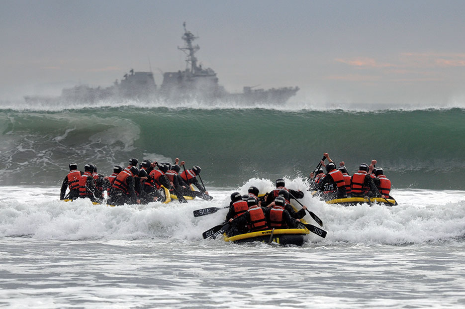 Basic Underwater Demolition/SEAL students participate in Surf Passage as part of first phase of SEAL training (U.S. Navy/Michael Russell)