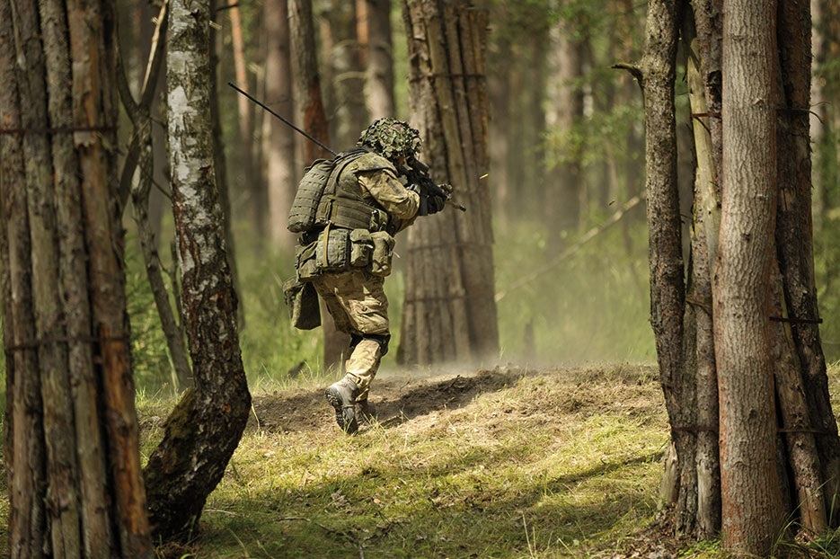 Danish soldier rushes objective during live-fire exercise at Joint Multinational Training Command's Grafenwoehr Training Area in Germany, July 4, 2014 (DOD/Markus Rauchenberger)