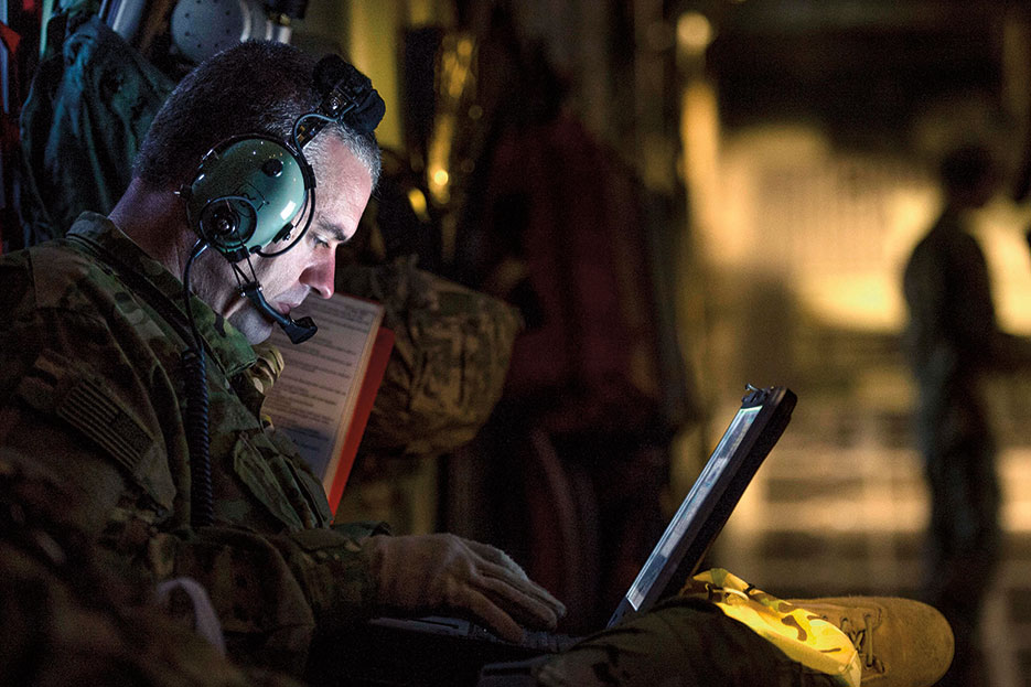 Airman assigned to 379th Expeditionary Aeromedical Evacuation Squadron logs patient's information into Electronic Health Record system in Southwest Asia to support Operation Inherent Resolve, January 6, 2016 (U.S. Air Force/Nathan Lipscomb)