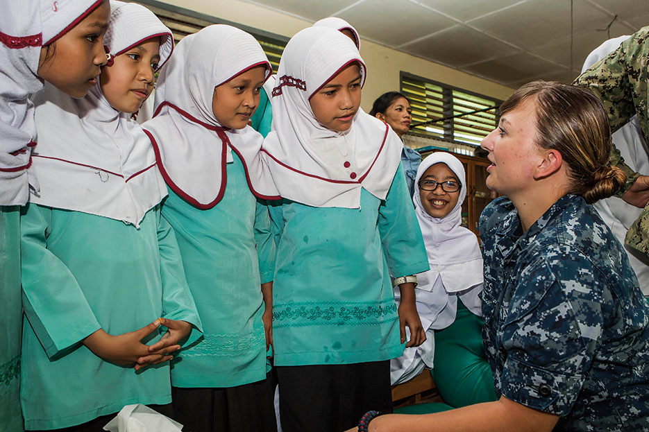 U.S. Navy Hospital Corpsman talks with students from Andalas Primary School during subject matter expert exchange held at Andalas Social Health Clinic, during Pacific Partnership 2016, August 26, 2016 (Royal Australian Air Force/David Cotton)