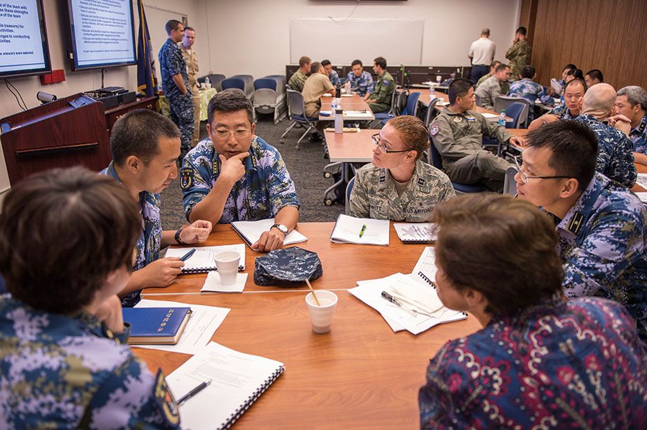 People's Liberation Army Navy hospital ship Peace Ark Senior Captain Sun Tao shares medical experiences during group activity during Fundamentals of Global Health Engagement Course at Makalapa Clinic as part of Rim of the Pacific 2016, Joint Base Pearl Harbor–Hickam, July 11, 2016 (U.S. Navy/Katarzyna Kobiljak)