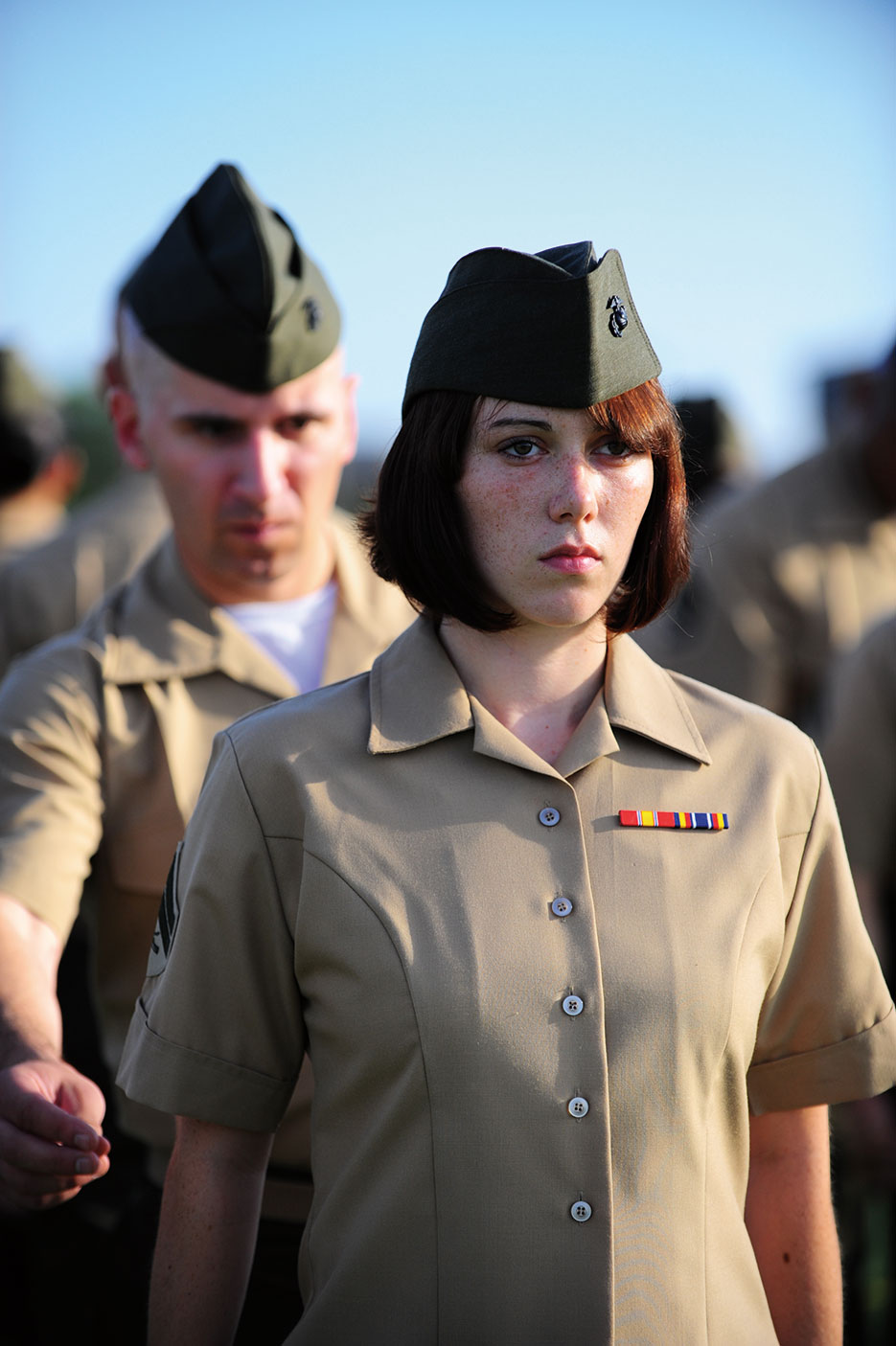 Instructor inspects Marine's uniform during 16-day Corporals Course, U.S. Marine Corps Enlisted Professional Military Education course, which was taught for first time at Dyess Air Force Base, Texas, August 5, 2010 (U.S. Air Force/Domonique Washington)