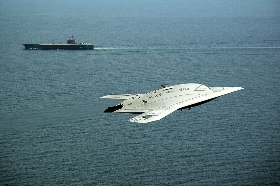 Unmanned Combat Air System X-47B demonstrator flies near aircraft carrier USS George H.W. Bush, first aircraft carrier to successfully catapult launch unmanned aircraft from its flight deck, May 14, 2013 (U.S. Navy/Erik Hildebrandt)