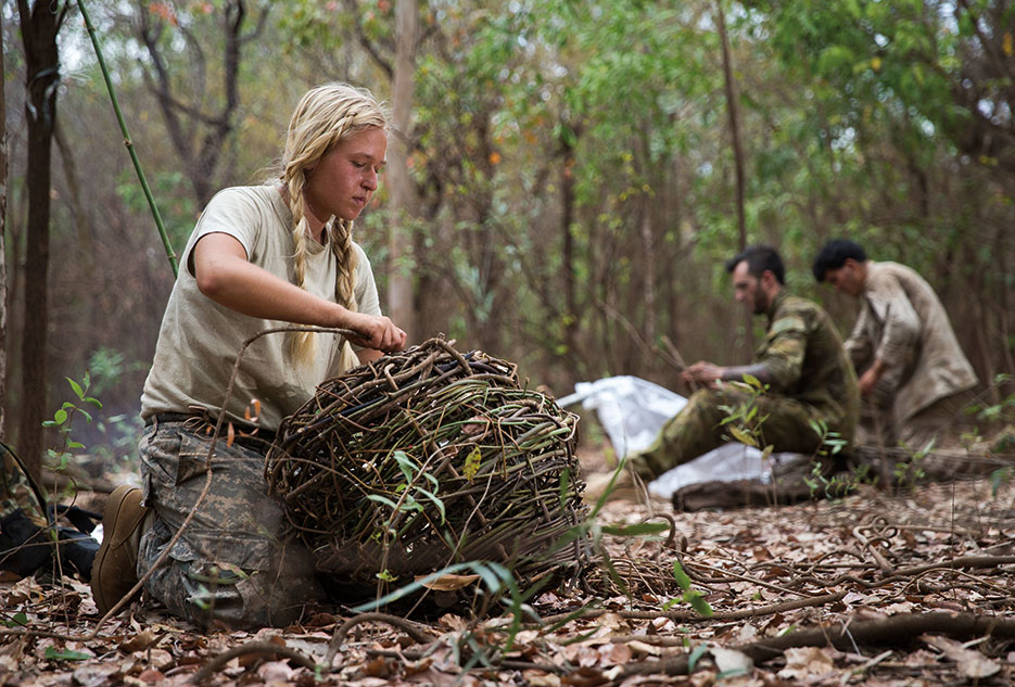 Soldier makes fish trap during survival phase of Exercise Kowari 2016, Australian army–hosted survival skills exercise designed to increase defense cooperation between forces from the United States, Australia, and China, September 4, 2016 (Australian Defence Force/Jake Sims)