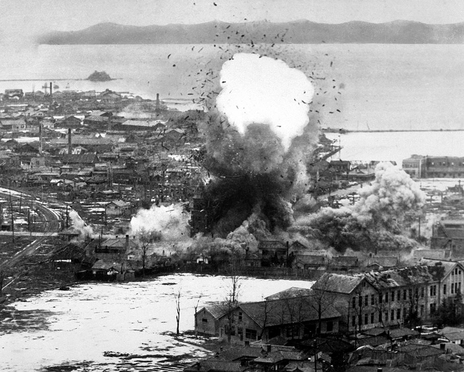 Supply warehouses and dock facilities at this important east coast port feel destructive weight of para-demolition bombs dropped from Fifth Air Force's B-26 Invader light bombers, Wonsan, North Korea, 1951 (U.S. Air Force/NARA)