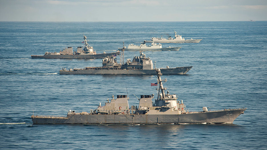 Guided missile destroyer Jinan, top, frigate Yiyang and guided missile destroyer USS Mason, center, guided missile cruiser USS Monterey and guided missile destroyer USS Stout, bottom, steam in formation during passing exercise in Atlantic Ocean, November 7, 2015 (U.S. Navy/Edward Guttierrez III)