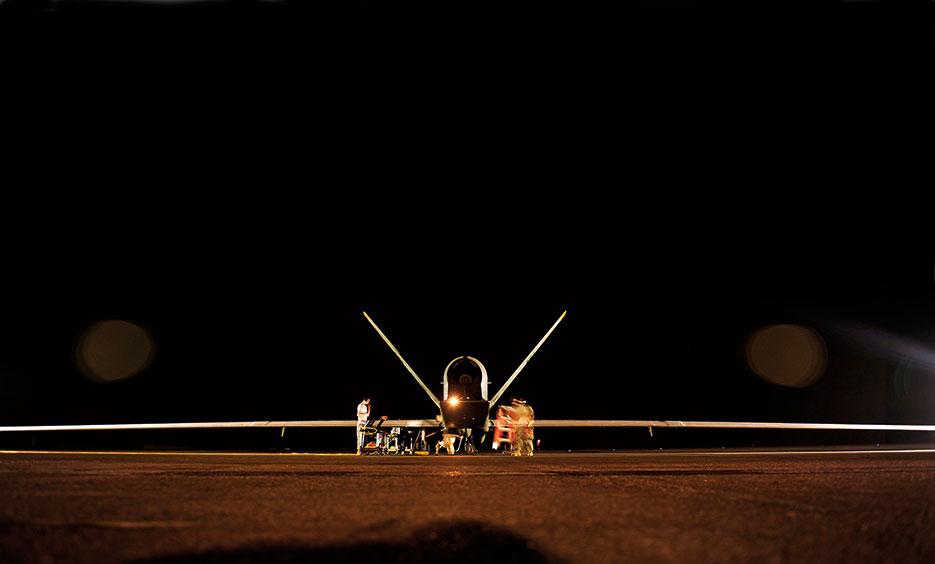 U.S. Air Force RQ-4 Global Hawk aircraft maintenance technicians perform preflight checks prior to mission, November 2010 (U.S. Air Force/Andy M. Kin)
