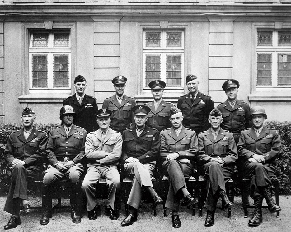 Senior American commanders in Western Europe, 1945; seated, left to right, William Hood Simpson, George S. Patton, Carl A. Spaatz, Dwight D. Eisenhower, Omar Bradley, Courtney Hodges, Leonard T. Gerow; standing, left to right, Ralph Francis Stearley, Hoyt Vandenberg, Walter Bedell Smith, Otto P. Weyland, and Richard E. Nugent (U.S. Army/National Archives and Records Administration)