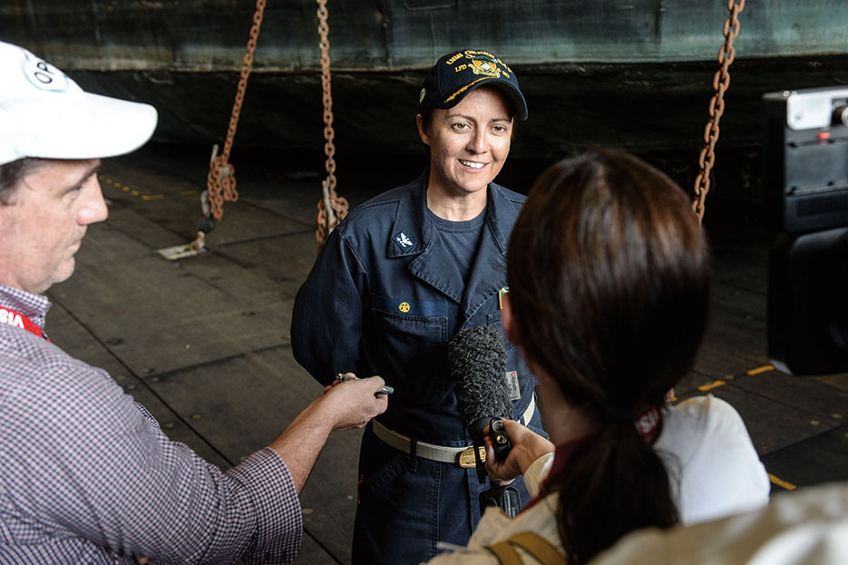 Captain of amphibious transport dock ship USS Green Bay speaks with Australian journalists while participating in Talisman Sabre 2015 (U.S. Navy/Derek A. Harkins)