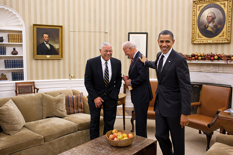 President Obama jokes with Vice President Biden and former Secretary of State Colin Powell following meeting in Oval Office, December 2010 (The White House/Pete Souza)