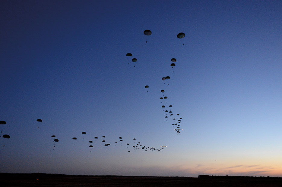 Soldiers conduct static line airdrop during Joint Operational Access Exercise 13-02, at Sicily drop zone, Fort Bragg, North Carolina, to train with paratroopers from U.S. Army's 82nd Airborne Division on projecting combat power in denied environments (DOD/Jason Robertson)