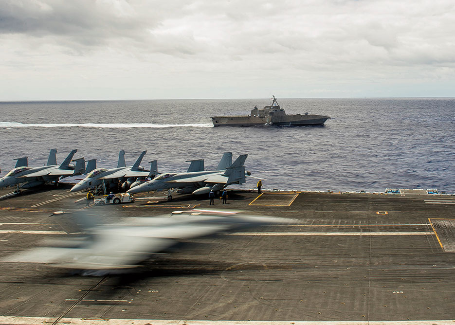 """E/A-18 Growler assigned to """"Gauntlets"""" of Electronic Attack Squadron 136 lands as USS Ronald Reagan and USS Independence conduct maneuvers during Rim of the Pacific 2014 (U.S. Navy/Conor Minto)"""