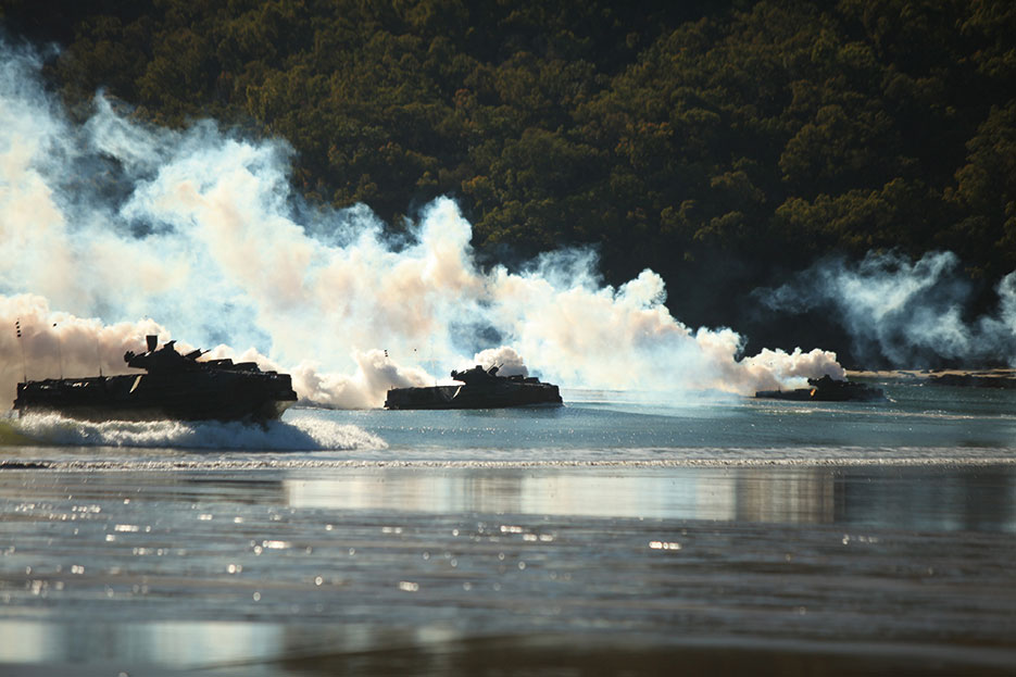 Amphibious assault vehicles carrying Company G, Battalion Landing Team 2nd Battalion, 7th Marines, 31st Marine Expeditionary Unit, charge onto Freshwater Beach during Exercise Talisman Sabre 2011, Queensland, Australia (U.S. Marines/Garry J. Welch)