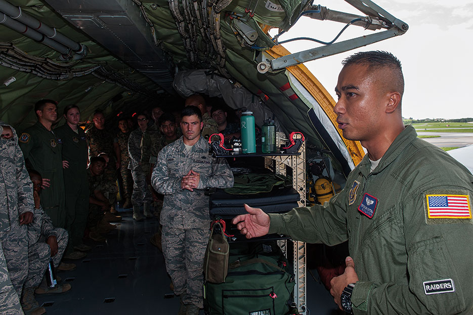 Airman from 18th Aeromedical Evacuation Squadron explains his role in aeromedical mission to students attending JPME Okinawa Experience, Kadena Air Base, Japan, September 2016 (U.S. Air Force/Corey M. Pettis)