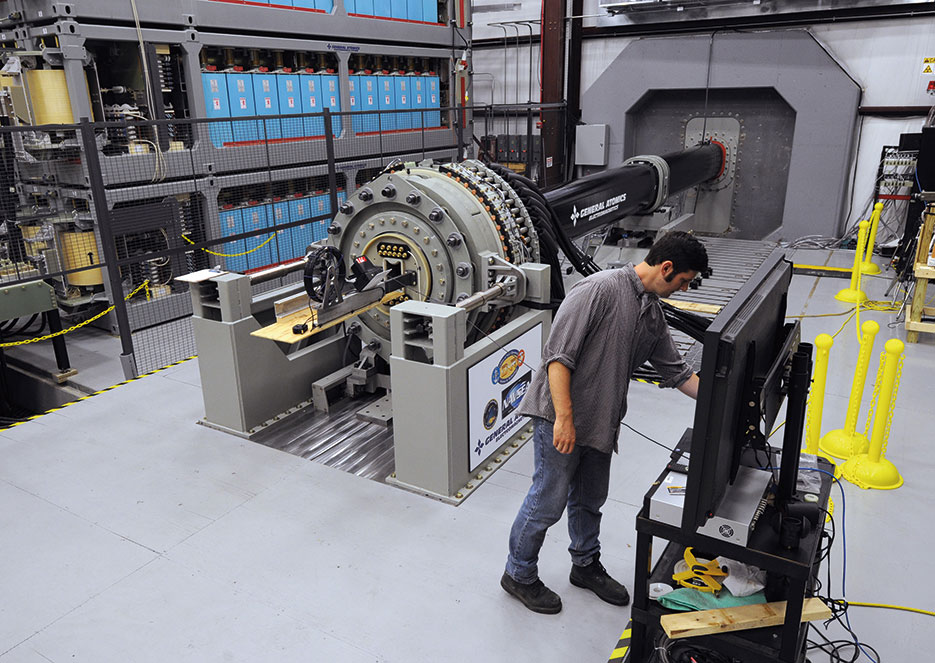Dan Wise, from Naval Surface Warfare Center, Dahlgren Division, prepares to take readings following successful test of Office of Naval Research–funded Electromagnetic Railgun, in Virginia, June 21, 2012 (U.S. Navy/John F. Williams)