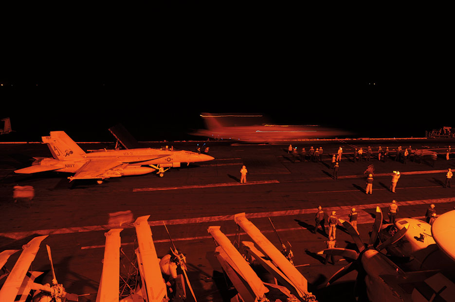 F/A-18E Super Hornet, attached to Strike Fighter Squadron 31, and F/A-18F Super Hornet, attached to Strike Fighter Squadron 213, prepare to launch from flight deck of USS George H.W. Bush to conduct strike missions against ISIL targets, September 2014 (U.S. Navy/Robert Burck)