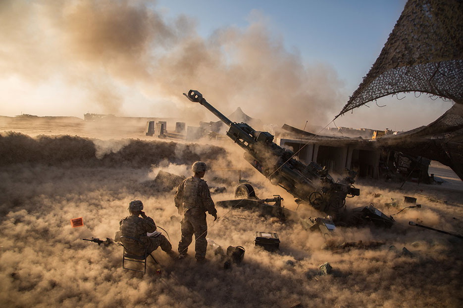 Soldiers assigned to Charlie Battery, 1st Battalion, 320th Field Artillery Regiment, 2nd Brigade Combat Team, 101st Airborne Division, fire M777 A2 Howitzer in support of Operation Inherent Resolve at Platoon Assembly Area 14, Iraq, November 2016 (U.S. Army/Christopher Brecht)