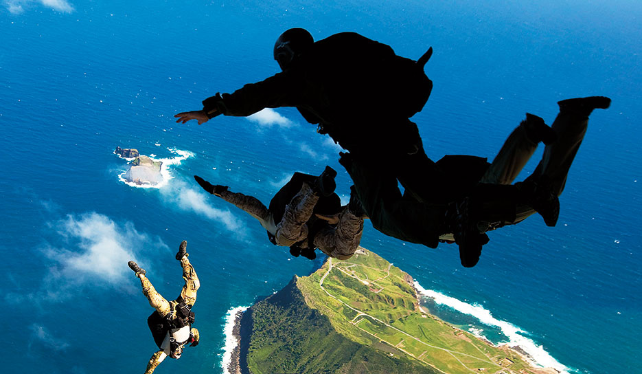 Air Force pararescuemen and West Coast–based Navy SEALs leap from ramp of Air Force C-17 transport aircraft during free-fall parachute training over Marine Corps Base Hawaii, January 2011 (U.S. Marine Corps/Reece E. Lodder)