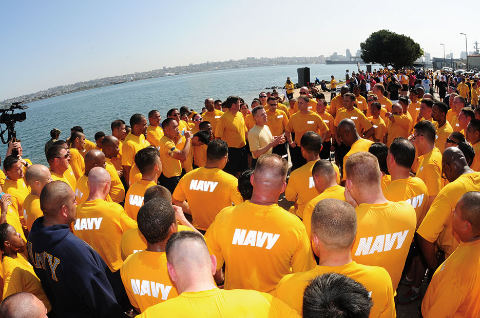 Commanding officer of USS Ronald Reagan talks to Reagan Sailors at Stomp Out Sexual Assault 5k run on Naval Air Station North Island, April 2013 (U.S. Navy/Omar Powell)