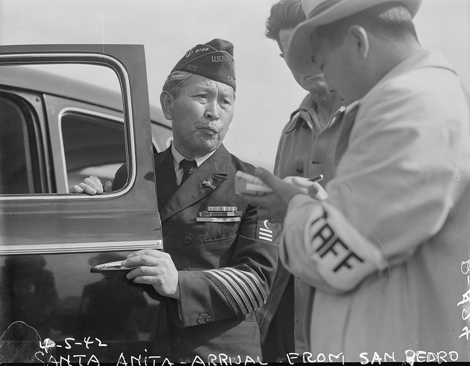 Dressed in uniform marking service in World War I, this veteran enters Santa Anita assembly center for persons of Japanese ancestry evacuated from West Coast, April 5, 1942, Arcadia, California (National Archives and Records Administration/Clem Albers)