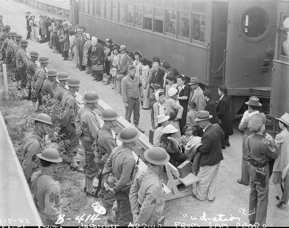 Persons of Japanese ancestry arrive at Santa Anita Assembly center from San Pedro, California, April 5, 1942, Arcadia, California (National Archives and Records Administration/Clem Albers)