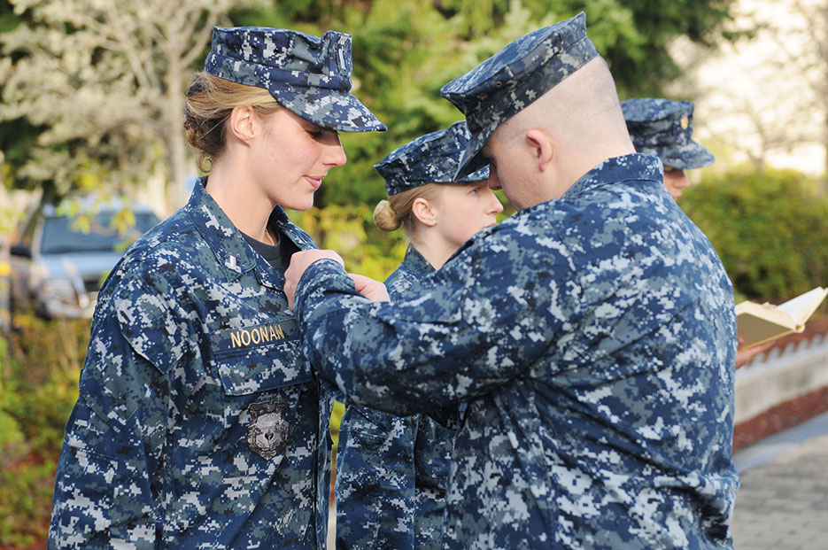 Sailor assigned to Blue crew of ballistic missile submarine USS Maine receives her submarine warfare officer device at Naval Base Kitsap-Bangor, Washington, December 5, 2012 (U.S. Navy/Ahron Arendes)