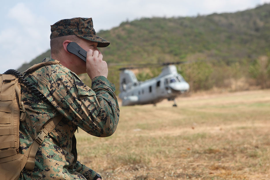 Air traffic controller with 31st Marine Expeditionary Unit communicates with pilot of CH-46E Sea Knight helicopter with Marine Medium Helicopter Squadron 262 (Reinforced), 31st MEU, during multilateral NEO exercise, February 12, 2011 (DOD)