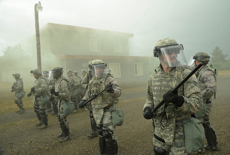 Security forces members from Oregon Air National Guard's 142nd and 173rd fighter wings train together during door-to-door search at training village in Warrenton, Oregon, during exercise Cascadia Rising, June 10, 2016 (U.S. Air National Guard/John Hughel)