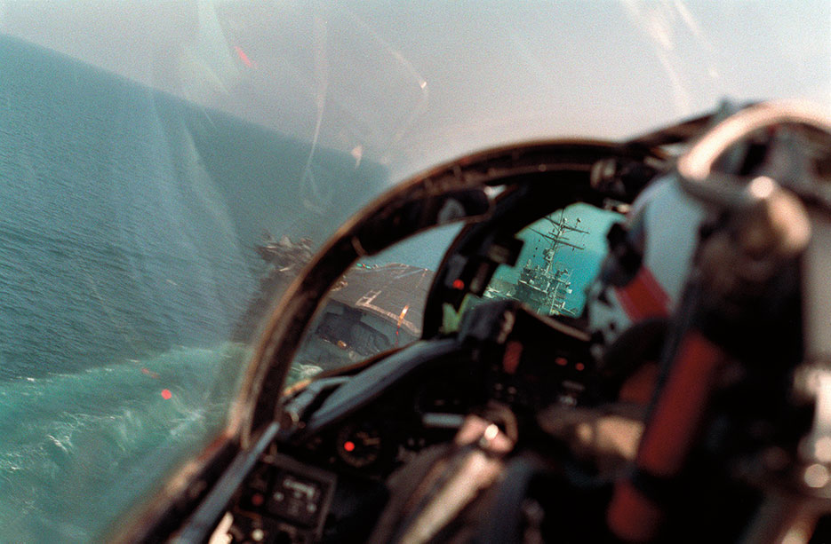 As seen from back seat of Fighter Squadron 41 F-14A Tomcat aircraft, pilot brings aircraft in for arrested landing on flight deck of USS Theodore Roosevelt during Operation Desert Storm (DOD/Parsons)