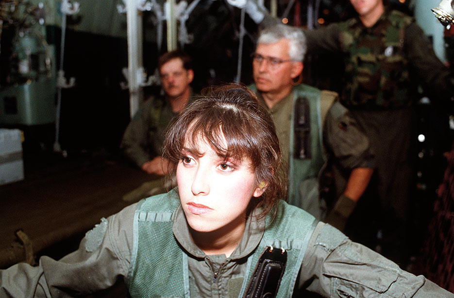 Airman, front, of 68th Aeromedical Evacuation Squadron (AES), Norton Air Force Base, Airman, right, of 118th AES, Tennessee Air National Guard, and Airman, left, of 137th AES receive mission briefing during Operation Desert Storm (U.S. Air Force/Kimberly Yearyean)