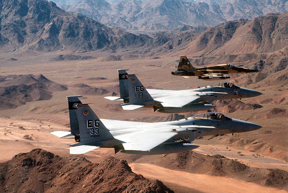 Air-to-air view of two U.S. Air Force F-15C Eagle fighter aircraft of 33rd Tactical Fighter Wing, Eglin Air Force Base, and Royal Saudi air force F-5E Tiger II fighter aircraft during mission in support of Operation Desert Storm (U.S. Air Force/Chris Putman)