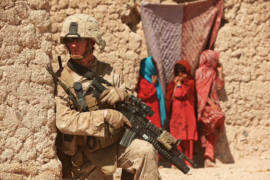 Marine with Mobile Assault Platoon 4, Weapons Company, 1st Battalion, 25th Marine Regiment patrols southern Washir District, Helmand Province, October 2, 2011