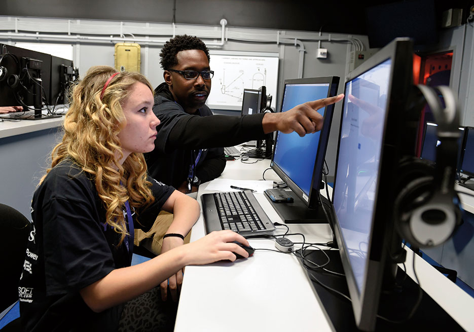 Joint Cyber Analysis Course instructor at Information Warfare Training Command Corry Station helps high school student complete cybersecurity challenges during third annual CyberThon event at Naval Air Station Pensacola, January 21, 2016 (U.S. Navy/Taylor L. Jackson)