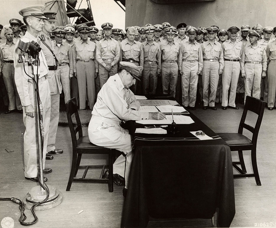 Supreme Allied Commander General Douglas MacArthur signs Instrument of Surrender on board USS Missouri, Tokyo Bay, September 2, 1945 <br />(U.S. Army Signal Corps)