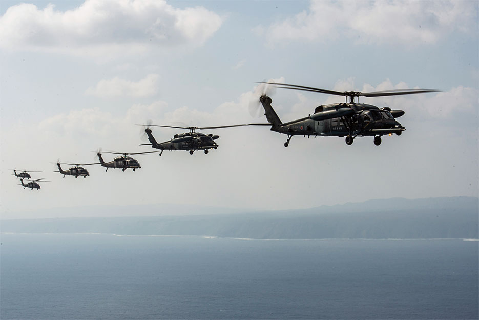 HH-60 Pave Hawks from 33rd Rescue Squadron, 943rd Rescue Group, and Japan Air Self-Defense Force fly in formation behind MC-130J from 17th Special Operations Squadron during exercise Keen Sword 17, November 7, 2016, near Okinawa, Japan (U.S. Air Force/Stephen G. Eigel)