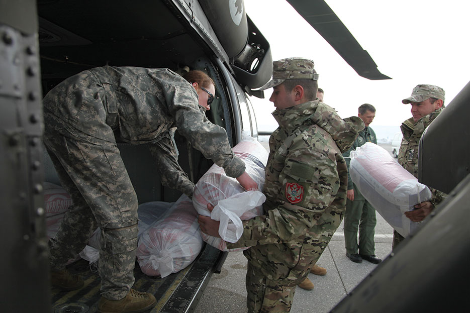 Soldiers begin loading supplies on UH-60 A+ Black Hawk, February 22, 2012, as part of task force to provide humanitarian assistance at request of government of Montenegro after heavy snowfall (U.S. Army/Edwin Bridges)