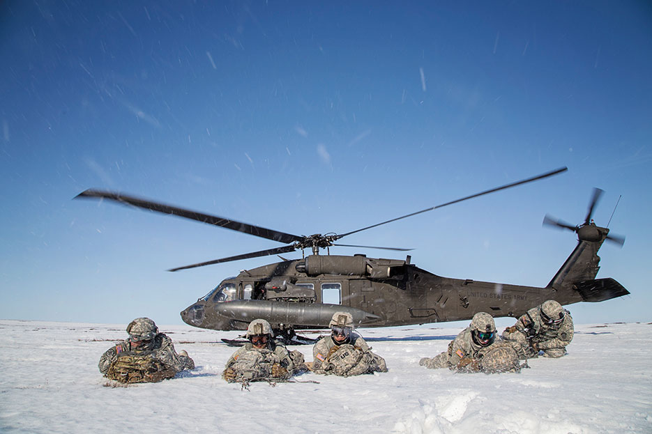 Paratroopers with 6th Engineer Battalion, 2nd Engineer Brigade, pull security after exiting UH-60 Black Hawk during exercise Arctic Pegasus near Deadhorse, Alaska, May 2, 2014 (DOD/Edward Eagerton)