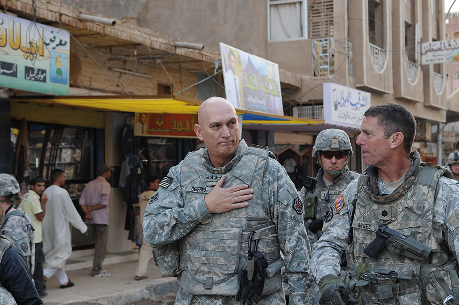General Ray Odierno, commanding general, Multi-National Forces–Iraq, and Lieutenant Colonel Joseph McGee, commander of 2-327 Infantry Battalion, 1st Brigade Combat Team, 101st Airborne Division, walk through streets of Samarra on October 29, 2008 (U.S. Army/Kani Ronningen)